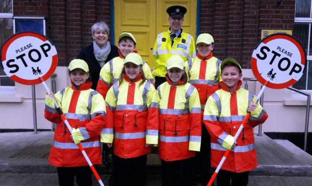 Patricia McKeever, Principal CBS Primary, and Garda Michael Fitzgerald with CBS Junior Wardens