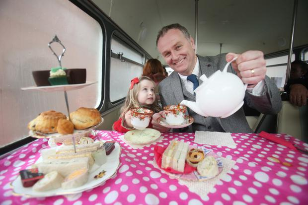 Dáithí Ó Sé pictured with Inès Brophy O'Connor, age 5 on the Vintage Tea Tour Bus