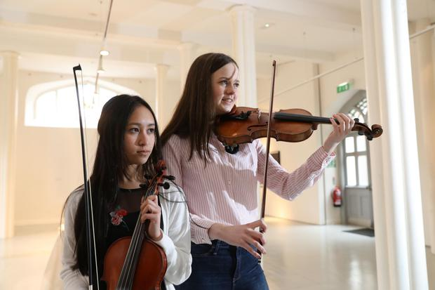 Kay Poole (16) and Fionnghuala Drumgoole (16) members of Nós Nua, a Louth youth folk Orchestra, pictured at the launch of Fleadh Cheoil na hÉireann today