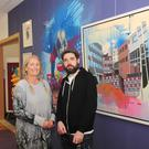 Úna Curley and Barry Finnegan at the Art As Exchange exhibition in the Community Room at The Longwalk Shopping Centre