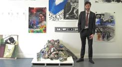 Artist Sean McGuill pictured with his final year exhibition