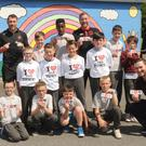 Principal, Michelle Murray, Teacher, Matthew McArdle, Pupils of 5th & 6th class along with Brian Gartland, Liam Burns and Michael Duffy, Dundalk FC at the launch of the Junior Entrepreneur Competition at Redeemer Boys National School