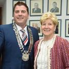 The newly elected Chairman of Louth County Council Cllr. Liam Reilly pictured with his mother Madge. In the background is a photograph of deceased former Cllr. Tommy Reilly