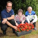 Ian Doyle, Mairead O'Hare and Shane McDermott at the garden party at LINKS, Hilltop, Ardee Road