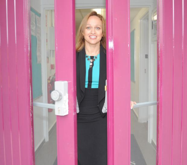 Jackie McCusker, Principal at Faughart Community National School opening the door on the first day of the new School term