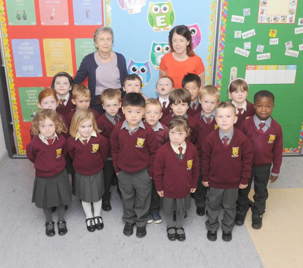 Helen Lord, Principal of Dun Dealgan National School, with Teacher, Miriam Donnelly with the Junior and Senior Infants class on the first day of the school term