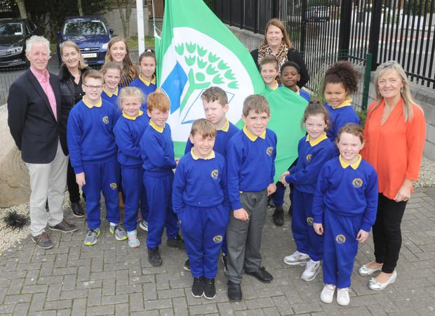 The Green School committee, with, Principal, Annette Mhic Ardaíl and former principal, Padraig MacCanna who raised the sixth Green Flag at Gaelscoil Dhún Dealgan