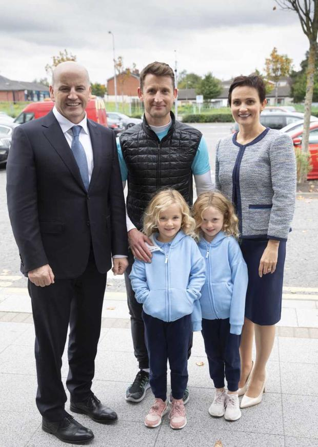Above, Seán Gallagher and his wife Trish at Dundalk Retail Park where they met Aaron Rogers and his daughters Lilly and Lucy