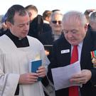 Fr. Mark O'Hagan chats with Jim Kerley at the unveiling ceremony of a memorial to the TSS Dundalk on the Navvy Bank. Picture: Ken Finegan