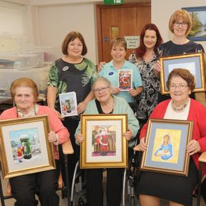 Sanda Charity, Codex Print Soloutions, Margaret O'Callaghan, Janet Malone and Marie Butler with Art teacher, Carol Wallace and members the Art group in St. Oliver Plunkett Community Unit. Included are, Bridie Connolly, Kathleen Maguire, Rita McCann and Briege Treanor.