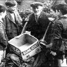 Wee Georgie surrounded by young boys who were fascinated by him in Roden Place