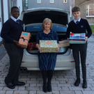 Pictured are Emmanuel Akinla (3rd yr), Ms Matthews (who organised the collection) and Milo Moore (3rd year)