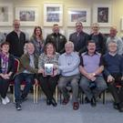 Members of Dundalk Photographic Society being presented with the Photographic Society of America PID International Interclub Winners plaque by Dominic Reddin, FIPF & President of the IPF