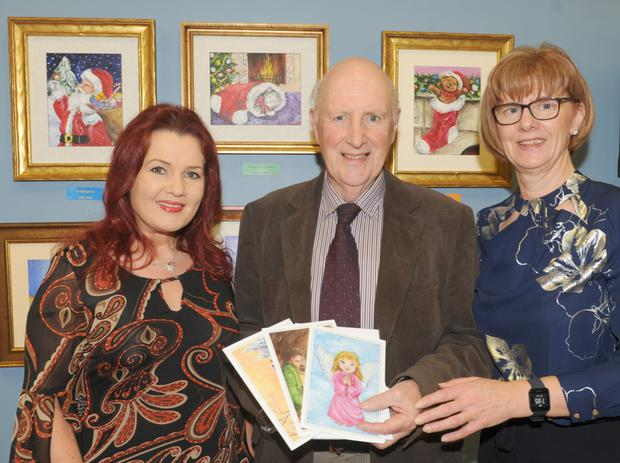 Kevin Mulligan, Area President, St. Vincent de Paul, with Carol Wallace and Marie Butler at the annual exhibition of paintings from the St. Olivers Art Group held in St Oliver Plunkett Community Unit