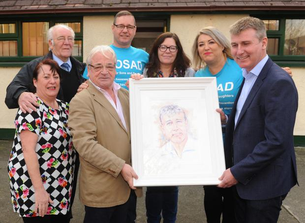Gerry Duffy makes a presentation to Dundalk FC manager Stephen Kenny at the SOSAD Centre, Dundalk, along with Cathy Cousins, Gerry Curtis, Mark Kelly, Ciara Solan and Maria O'Toole.