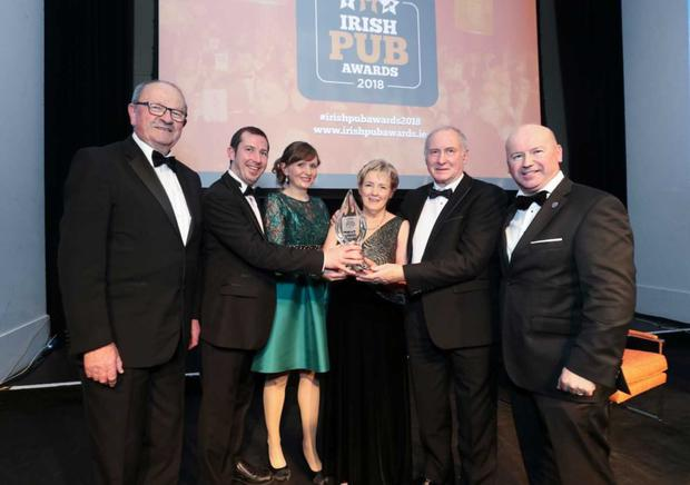 The Glyde Inn being presented with their award