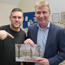Darren Rafferty presented one of 2019 calendars to Stephen Kenny at a SOSAD event