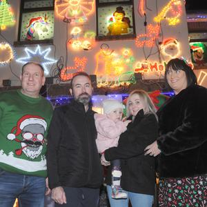David Stevenson (left), Eamon Murphy, Zoe Murphy, Lynda Bannon and Mandy Stevenson at the switching on of the Christmas lights in aid of The Zoe Murphy Appeal at Mandy Stevenson's house in Manydown Close