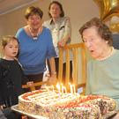 Annie Bishop blowing out the candles on her 100th birthday on 6th December. Photos by Aidan Dullaghan/Newspics
