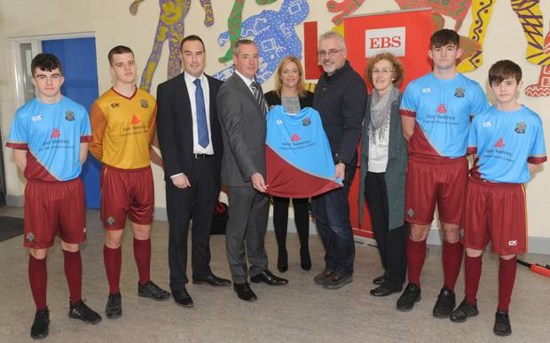 Paul Murray, Alan Sweeney and Lisa Kelly, EBS present sets of jerseys to Soccer Manager at De La Salle College, Declan McGrath, with Principal, Patricia O'Leary along with players, Barra Duffy, Donal Leavy, Gavin Gregory and Sam Alderdice.