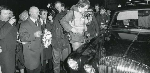 Former Louth Deputy, Joe Farrell with a wreath for his cousin Mairead Farrell as the hearses carrying the remains of the Gibraltar Three passes through Dundalk in March 1988