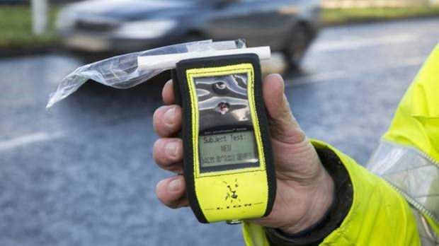 A handheld drink driving test device