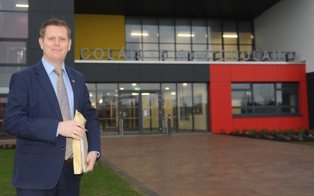 Principal, Tomás Sharkey at the entrance to Coláiste Chú Chulainn as they start the new term in their new complete building