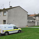 Gardai at the scene of the petrol bombing in Muirhevnamor