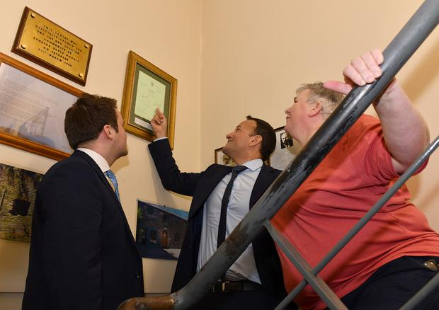An Taoiseach Leo Varadkar points to his signature on the 2015 Marriage Equality Bill watched by Cllr. John McGahon and Bernardine Quinn during his visit to Dundalk Outcomers. Picture Ken Finegan/Newspics