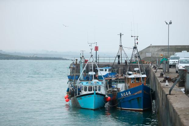 Two Northern Ireland registered vessels fishing boats seized by the Irish Navy moored in the port of Clogherhead in Co Louth after they were caught fishing in Dundalk Bay