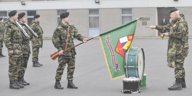 Fr. PJ Somers blessing the unit colours. Pictures: Aidan Dullaghan/Newspics