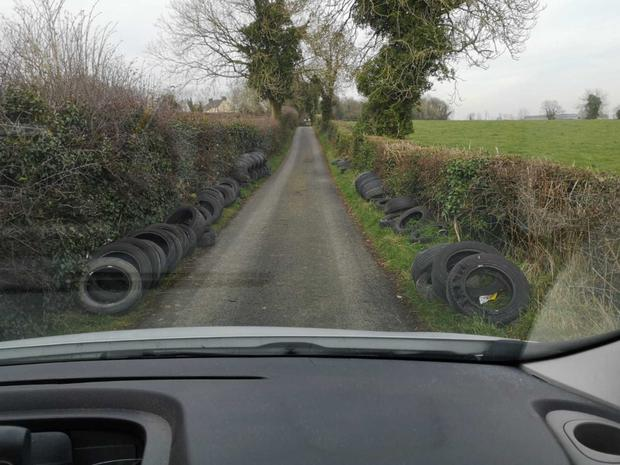Tyres dumped at the side of a road in Annavacky.
