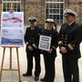 Greenore native James Larkin (right) CUSM unveils the new stamps with colleagues from the Irish Coastguard