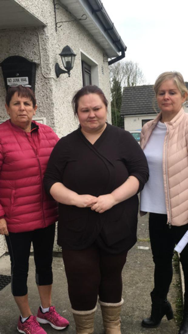 Catherine (centre) pictured with supporters as she battled eviction from her home