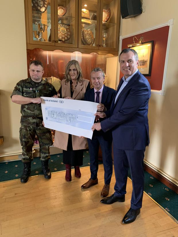 Presenting the cheque (from left) Johnny Gray, Mary Murdock and Gary Valentine, from Dundalk RFC and Paul Early, National Breast Cancer Research Institute