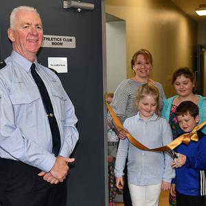 Andrew Golden together with his mother Nicola and sisters Alexandra and Lucy cut the ribbon at the naming ceremony of the Golden Room in memory of the late Gda. Tony Golden watched by Gda. Aidan Hanlon, Sgt. Vincent O'Connell and Insp. Darren Kirwan at the Big Hello held in Blackrock
