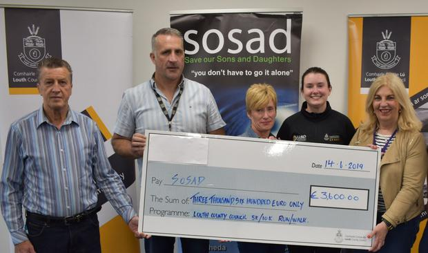 Staff from Louth County Council present a cheque for €3,600 to Maddie Morgan from SOSAD, following 5k/10k walk and run which took place in Dundalk and Drogheda recently
