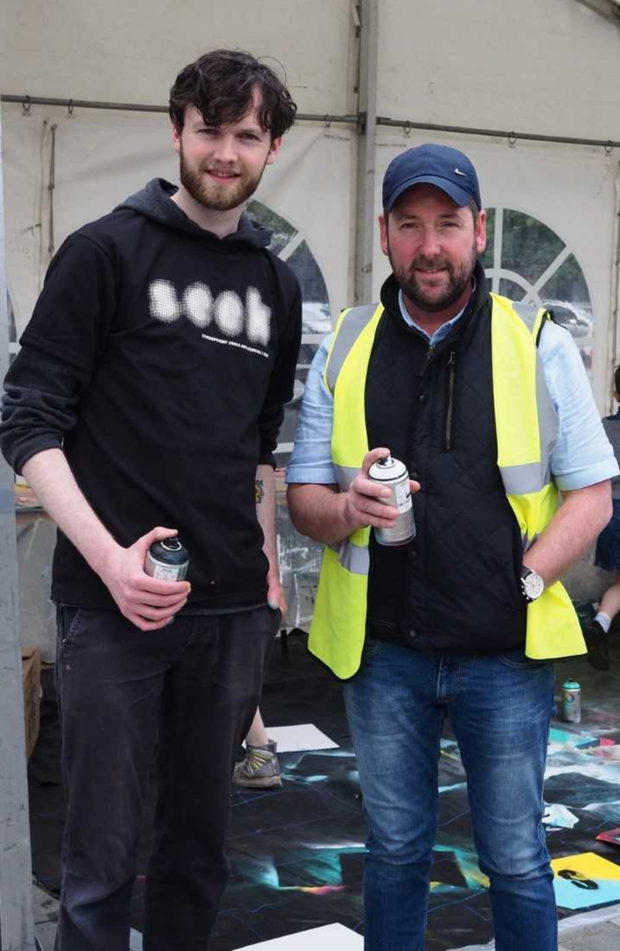 Local artist Sean McGuill with Town Centre Commercial Manager Martin McElligott during the Seek Festival