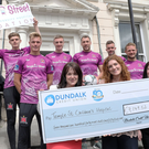 Denise Fitzgerald, Chief Executive Officer, Children's Health Foundation at Temple Street Hospital; Emma Hunt Duff Duffy, Sales and marketing Manager, Fyffes and Celine Nic Oireachtaigh, Temple Street Hospital, pictured with Dundalk FC players Sean Gannon, Daniel Cleary, Daniel Kelly, Brian Gartland (captain), Robbie Benson and Dane Massey as the team presented Temple Street Hospital Foundation with a cheque for over €7,000