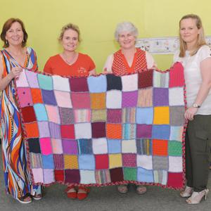 Madonna Lambert, Principal, ScoilMhuiregan Smál,Kilkerley, Teacher, Aisling Fahy, Geraldine Kirk, Chairperson, School Board of Management with a comfortblanket made by pupils in the School, which was presented to Adele Gorman (right), Our Lady of Lourdes Hospital