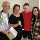 Mizu's Linda Stewart (left) and Sinead Linnane of Alumier Skincare make a presentation to Grainne Hearty with her son Odhran Coburn