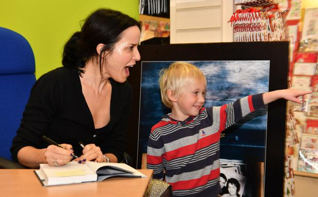 Luca McCreehan with Andrea Corr at Andrea's book signing held in Eason's. Picture Ken Finegan/Newspics