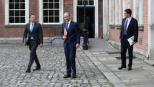 Minister for Enterprise Leo Varadkar, Taoiseach Micheal Martin and Minister for Climate Action Communications Networks and Transport Eamon Ryan leaving the Cabinet Meeting in Dublin Castle following the Government announcement of the stimulus package. Photo: Stephen Collins /Collins Photos Dublin