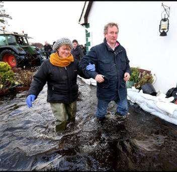 Taoiseach Enda Kenny with a householder in the floods which surround Athlone last week