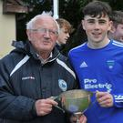 Outgoing Chairman Gerry Gover presents Conor McGowan, Under 16 Glenmuir United with the league trophy in this year's Schoolboys' League following a play-off victory
