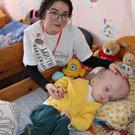 Louth Rose, Aoife Heffron, with one of the young children she met while there