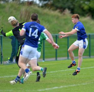 Action from the St Mary's v Geraldines match: Ciarán Keenan, St. Mary's, knocks the ball past Geraldines' Sean McEneaney for a goal. Picture: Ken Finegan/Newspics