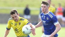Stephen McCooey of St. Mochta's and Mark Whelan of Naomh Mairtín in action on Sunday in Dunleer