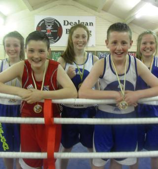 Dealgan Boxing Club members show off their medals.