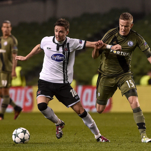 Dundalk FC's Ronan Finn holds off Legia Warsaw's Nemanja Nikoli in the Champions League play-off 1st leg